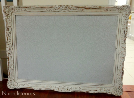 perisian inspired upholstered cork board with old distressed picture frame