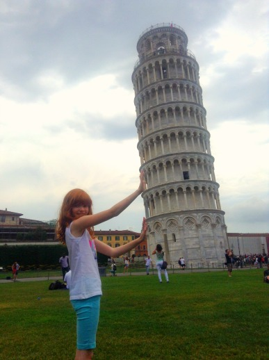 Holding up the leaning tower of Pisa in Italy