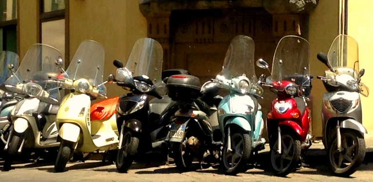 Motorbikes line the streets in Florence, Italy