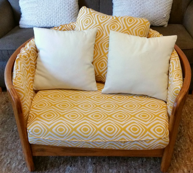 solid oak bentwood chair done in a yellow and cream mid century inspired fabric