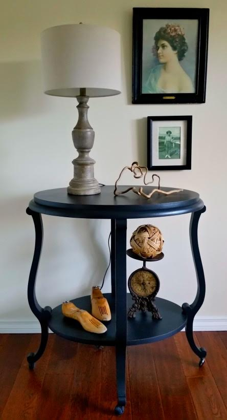 black antique table on casters