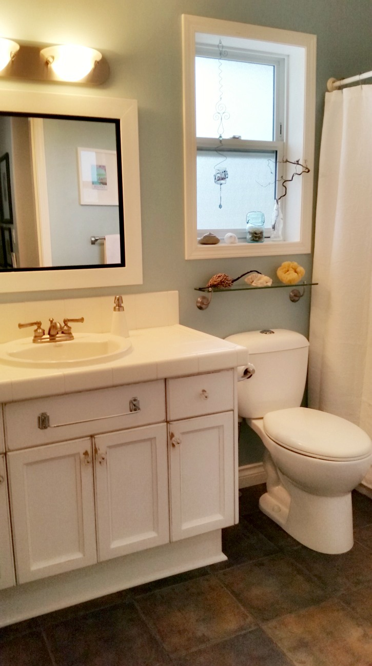 coastal beach themed bathroom painted in Benjamin Moore's Summer Shower