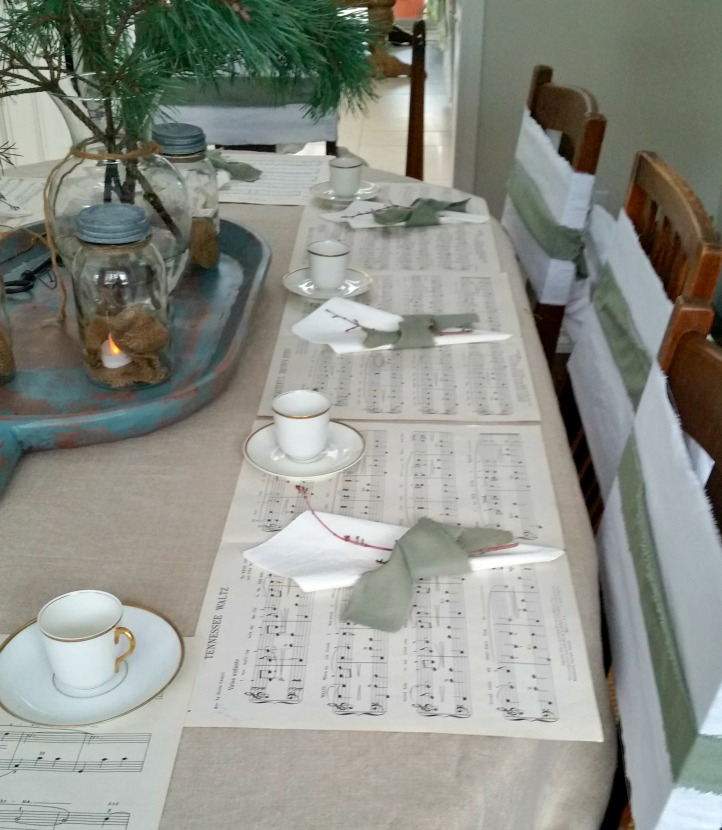 Christmas Table done in a French Country Flair with music sheet place settings