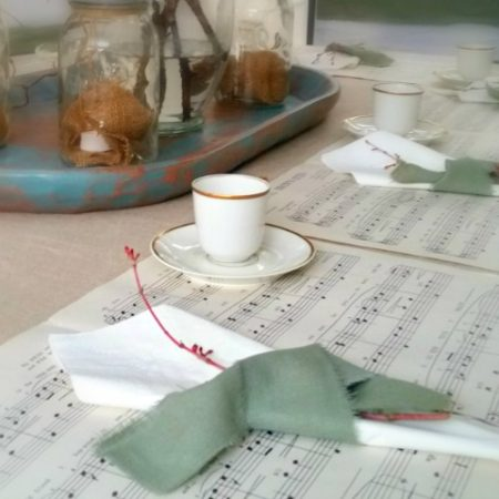 Christmas table place setting with music sheets and French China